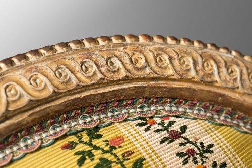 A rare pair of Louis XVI gilt wood armchairs -