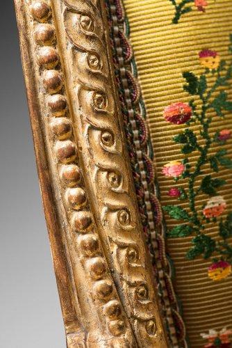 18th century - A rare pair of Louis XVI gilt wood armchairs