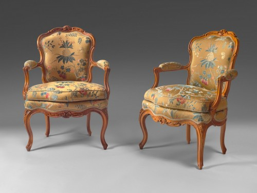 Seating  - A pair of Louis XV walnut armchairs attributed to P. Nogaret