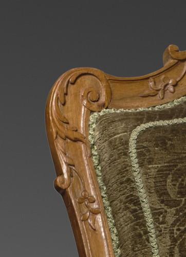 A Regence beechwood fauteuil -