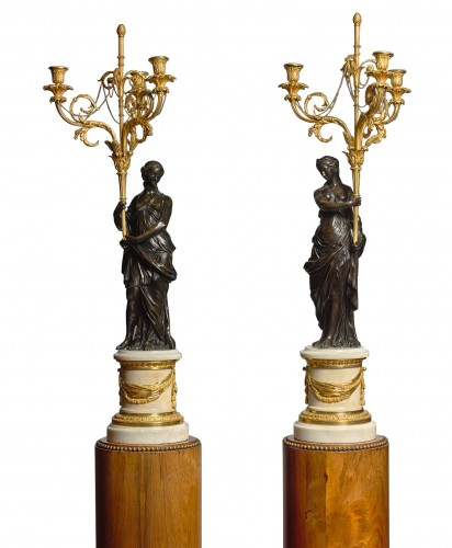 A pair of Louis XVI ormolu and patinated bronze three-lights candelabras