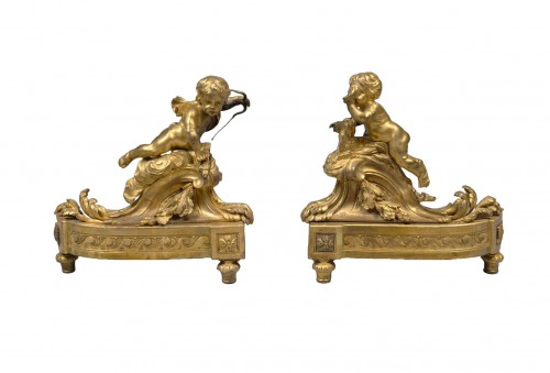 A pair of Louis XVI ormolu Chenets