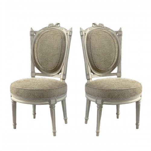 An elegant pair of Louis XVI grey-painted chairs