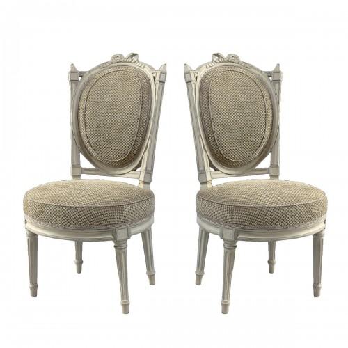 An elegant pair of Louis XVI grey-painted chairs