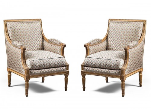 A pair of Louis XVI giltwood bergeres Attributed to Jean-Baptiste Boulard