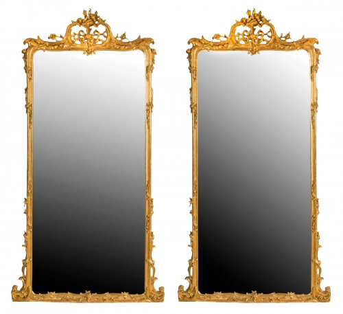 Pair of large wooden-framed mirrors dating from the second half of the 19th century