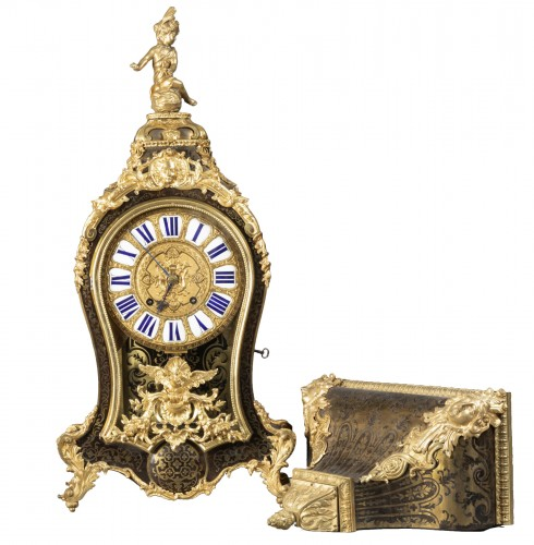 Cartel and its console of applique of the beginning of the time Louis XV