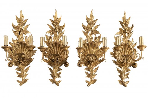 Suite of 4 gilt wood sconces from the end of the 18th century.