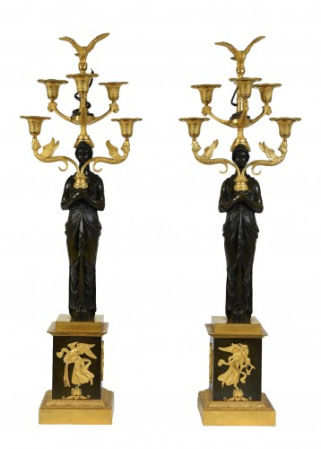 A pair of Empire Period, ormolu and patinated bronze candelabra
