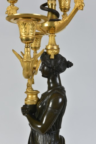 A pair of Empire Period, ormolu and patinated bronze candelabra -