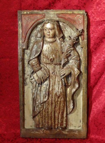Carved and polychromed wood panel featuring a holy martyr