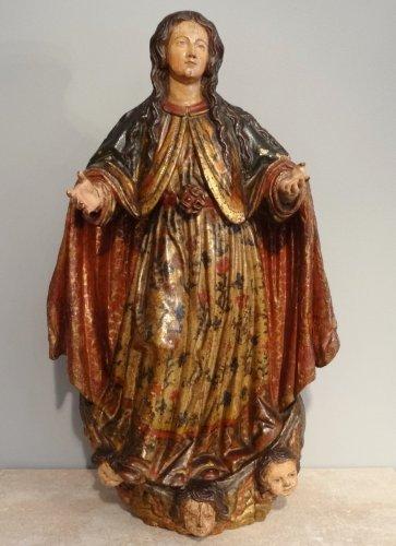 A XVIIth century carved and polychromed Virgin