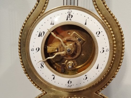 A 19th century  lyre-shaped clock - Clocks Style