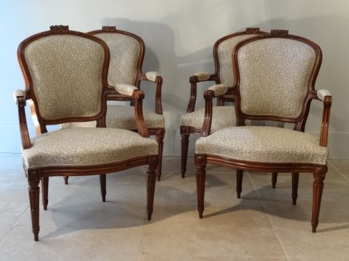 Four armchairs in carved walnut, France Lyon, 18th century