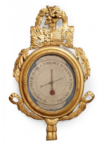 Louis XVI thermometer barometer in carved and gilded wood
