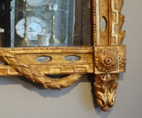 Mirror Louis XVI with parceloses in gilded wood 18th century -