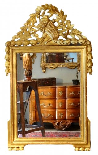 Louis XVI Mirror in gilded wood with attributes of gardener 18th century