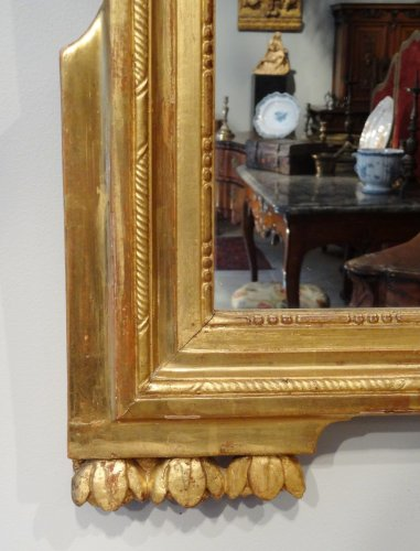 18th century - Louis XVI Mirror in gilded wood with attributes of gardener 18th century