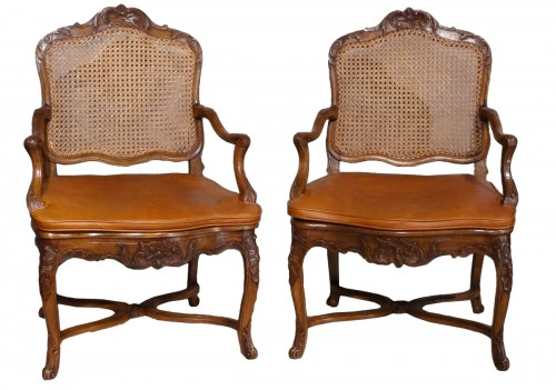 French Regence caned fauteuils, 18th century