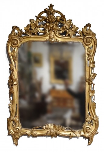 French Louis XV mirror in gilded wood, 18th century