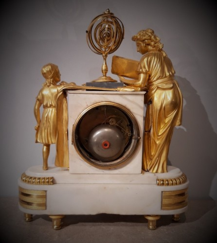 """Antiquités - Pendulum """"the lesson of Astronomy"""" in gilded bronze, 18th  century"""