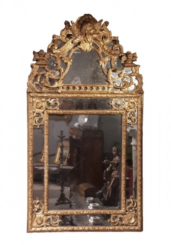 Louis XIV mirror in gilded wood, with glazing beads from the end of the 17t