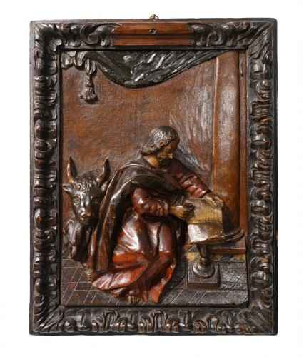 Polychrome carved wooden panel representing Saint Luke, 17th century