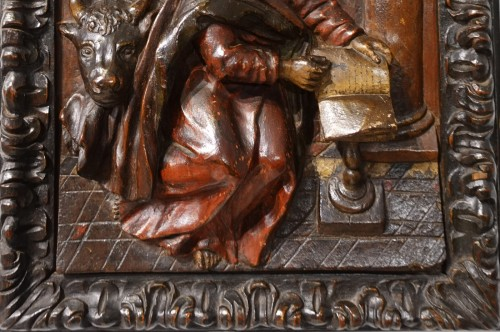 Sculpture  - Polychrome carved wooden panel representing Saint Luke, 17th century