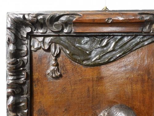 Polychrome carved wooden panel representing Saint Luke, 17th century -