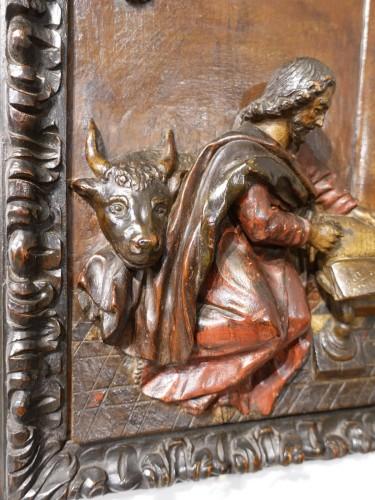 17th century - Polychrome carved wooden panel representing Saint Luke, 17th century