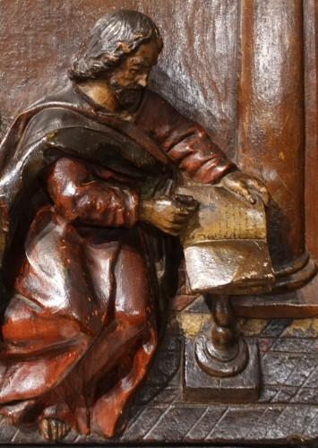 Polychrome carved wooden panel representing Saint Luke, 17th century - Louis XIV