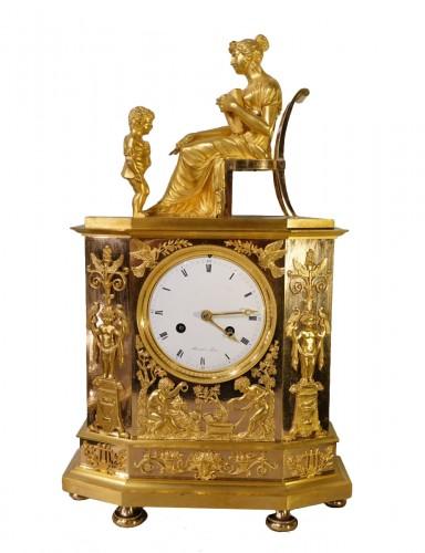 "French Restauration Gilt bronze clock signed ""Mesnil in Paris"""