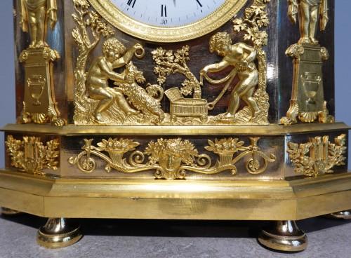 "Antiquités - French Restauration Gilt bronze clock signed ""Mesnil in Paris"""