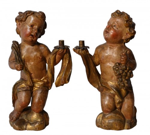 Pair of polychrome wooden Putti, 17th century