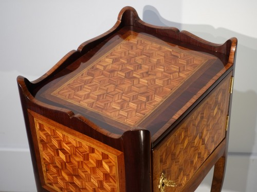 Louis XV bedside table in marquetry -