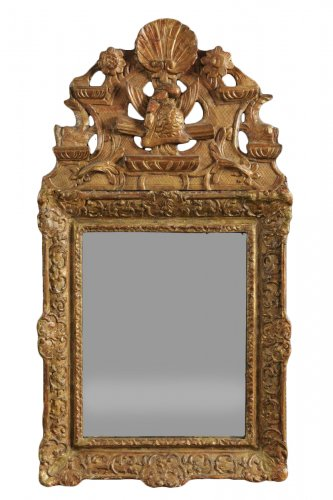 A French Regence carved pediment mirror