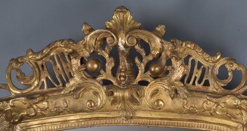 Mirrors, Trumeau  - A French Regence period giltwood mirror