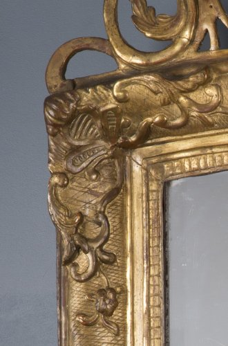 A French Regence period giltwood mirror -