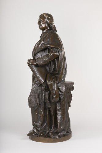 A bronze figure of Bossuet by Albert-Ernest Carrier Belleuse -