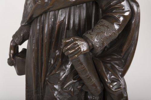 - A bronze figure of Bossuet by Albert-Ernest Carrier Belleuse