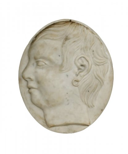 marble medallion depicting a young man
