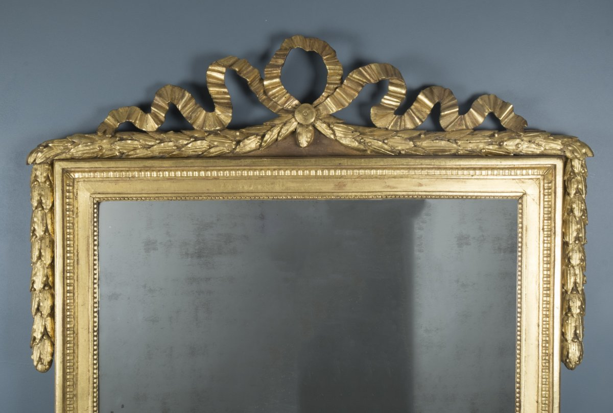french louis xvi giltwood mirror with carved pediment