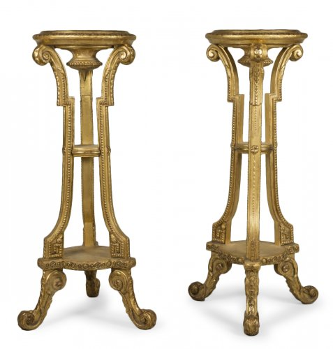 Pair of giltwood and stucco stands