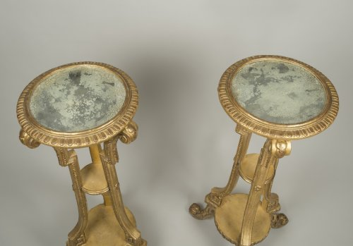 - Pair of giltwood and stucco stands