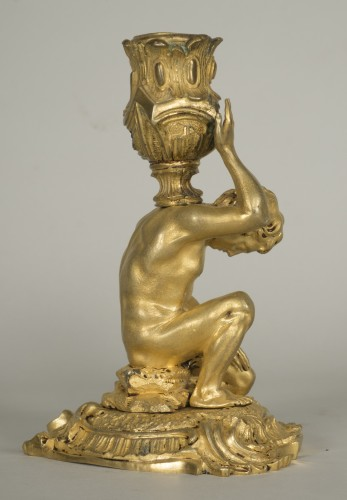 Lighting  - Gilt bronze candlestick depicting a man sat on a rock