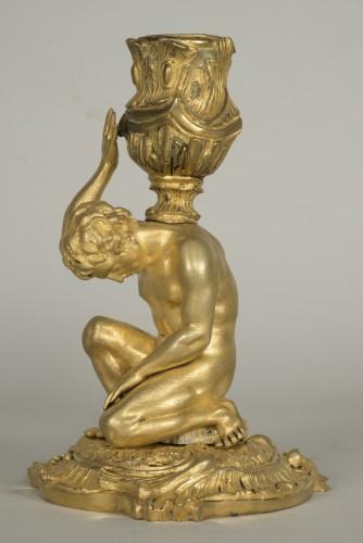 18th century - Gilt bronze candlestick depicting a man sat on a rock