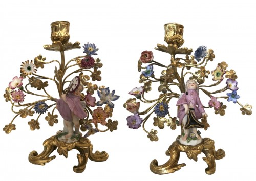 Pair of porcelain and gilt bronze candlesticks