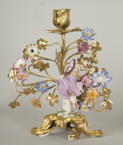 Pair of porcelain and gilt bronze candlesticks -