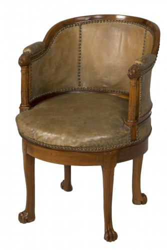 Spinning blond mahogany chair with leather