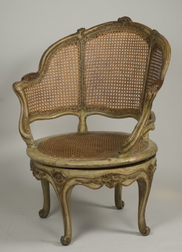 Carved and lacquered walnut spinning chair with cane attributed to Nogaret - Seating Style Louis XV